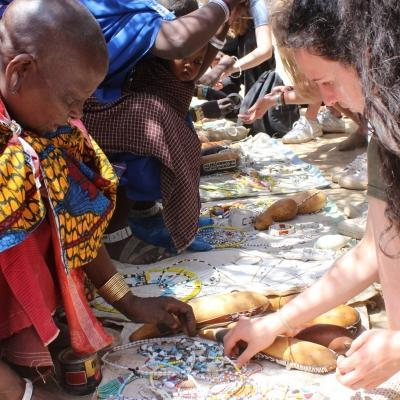 A volunteer looking at beaded jewellery during a Projects Abroad cultural exchange programme abroad.